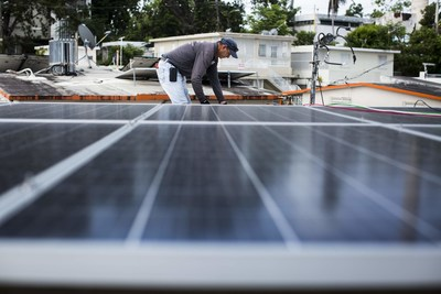 Solar panels are installed at Clínica Iella in San Juan, Puerto Rico, on July 5, 2018. The system, funded by Direct Relief, will help the clinic maintain operations in the event of a power interruption. (Photo by Erika P. Rodriguez for Direct Relief)