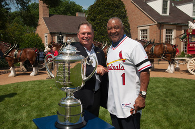 National Baseball Hall of Fame Member Ozzie Smith (r) delivers the Wanamaker Trophy to PGA Secretary Jim Richerson to kick off the 100th PGA Championship Week at Bellerive Country Club in St. Louis.