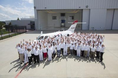Honda Aircraft Company associates celebrate the delivery of the first HondaJet Elite.