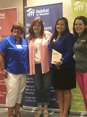 CITGO Corpus Christi Government & Public Affairs Manager Christina Cisneros-Guzman accepting the 2018 Business Partner of the Year award from Habitat for Humanity staff: Christine Panagopoulos, Senior Director of Construction at Trinity Habitat for Humanity; Patty Butters, Executive Director of Aransas County Habitat for Humanity; and Amy Ledbetter Parham, Executive Director of Habitat for Humanity Texas.