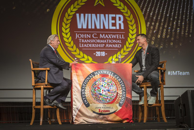 Movement Mortgage CEO Casey Crawford (right) joins John Maxwell on stage in Orlando, Florida.