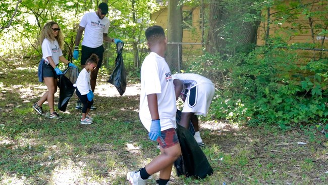 Sonny Weems (left) hosted a community clean-up during the 6th Annual Weems Week. People of all ages and from all walks of life helped to pick up trash as children would prepare to return to school the following week.