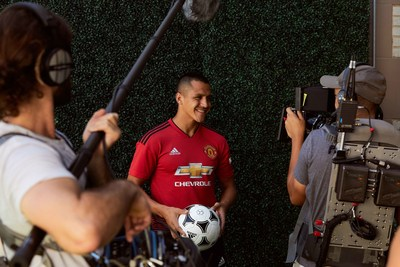 "• Manchester United forward, Alexis Sanchez, smiles down the lens during a Chivas film shoot in July in Los Angeles, United States. The film was released to announce Chivas as the ""Official Global Spirits Partner"" of Manchester United."