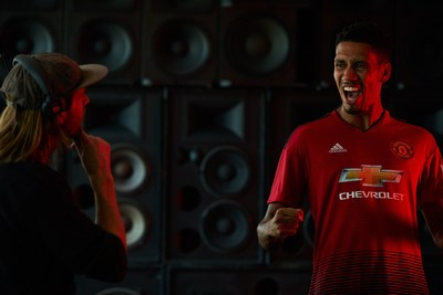 "• Manchester United defender, Chris Smalling, celebrates in front of a wall of speakers during a Chivas film shoot in July in Los Angeles, United States. The film was released to announce Chivas as the ""Official Global Spirits Partner"" of Manchester United."