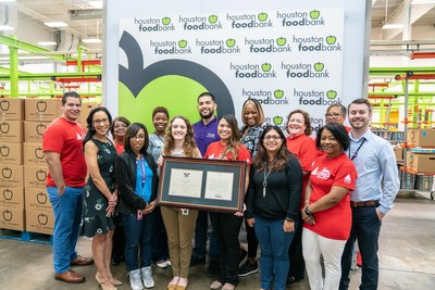 TeamCITGO volunteers and Houston Food Bank employees gather with the Bronze President's Volunteer Service Award (PVSA) at the Food Bank.