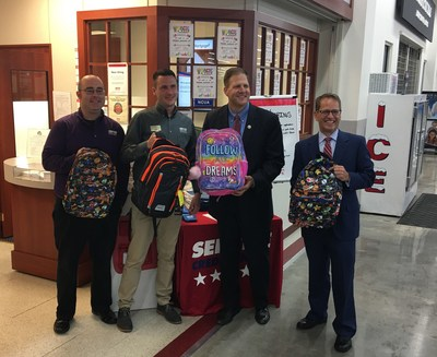 Proudly showing off the backpack donations in Salem, from left to right, are Service Credit Union Salem Branch Manager Justin Kimbrough, Service Credit Union Salem In-Store Branch Manager Scott DuCharme, New Hampshire Governor Chris Sununu and New Hampshire Department of Education Commissioner Frank Edelblut.