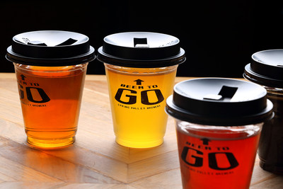 Craft beer in a plastic cup with a lid