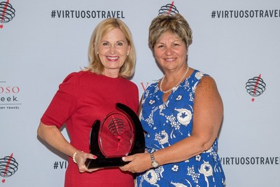 Protravel President Becky Powell and Protravel Senior Vice President of Operations Michele Capaccio accept the Virtuoso Top Network Producer Award at the Virtuoso Travel Week Opening Ceremony last night.