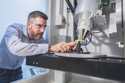 Dr. Fabrice Bernier, researcher at the NRC, uses an X-ray micro-tomography machine to analyze powders used in 3D printing. (CNW Group/National Research Council Canada)