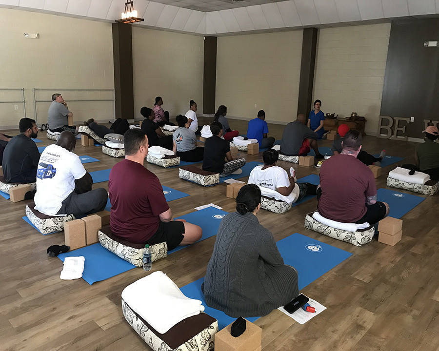 Warriors and guests participate in yoga lessons as part of Wounded Warrior Project's physical health and wellness program.
