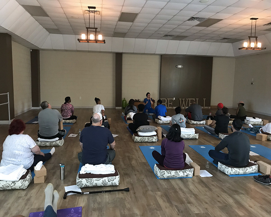 Warriors learn relaxation methods through yoga during Wounded Warrior Project physical health and wellness program.
