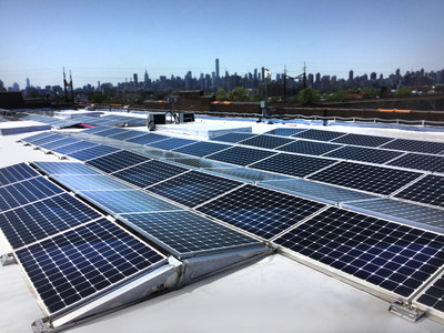 The Bay Street Senior Housing solar project, designed and installed by Quixotic Systems Inc. for the Arker Companies, will offset the building's electricity use for shared areas by 87 percent.