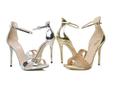 Single sole sandals in silver specchio and ornamented gold. (PRNewsfoto/Novus Inc.)
