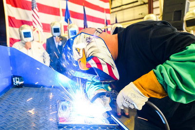 A welder authenticates the keel of LCS 23, the future USS Cooperstown, by welding the initials of keel authenticator Ellen R. Tillapaugh, Mayor of the Village of Cooperstown, New York. The Keel Laying is the formal recognition of the start of the ship's module construction process.