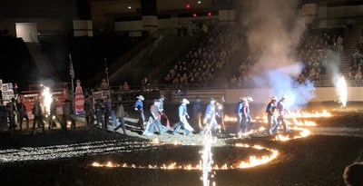 Bull riders enter the arena in a photo provided by warrior Chris Roberts