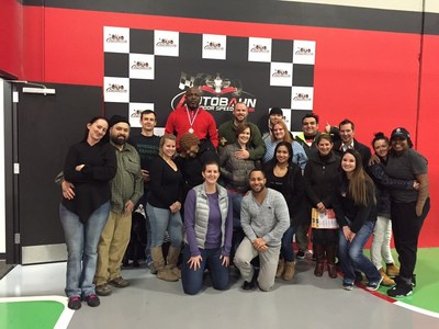 Warriors and their families bond over grand prix go-karts during a Wounded Warrior Project event
