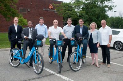 From left to right : Jeff Desruisseaux, project manager for BIXI Montréal, Alan DeSousa, Saint-Laurent Mayor, Luc Sabbatini, CEO of PBSC Solutions Urbaines, Jacques Cohen, Borough Councillor for the Côte-de-Liesse district, Christian Vermette, General Manager of BIXI Montreal, Francesco Miele, City Councillor for the Côte-de-Liesse district, Marie-Elaine Farley, Chair of the Board of Directors of BIXI Montreal, Aref Salem, City Councillor for the Norman-McLaren district. (CNW Group/Ville de Montréal - Arrondissement de Saint-Laurent)