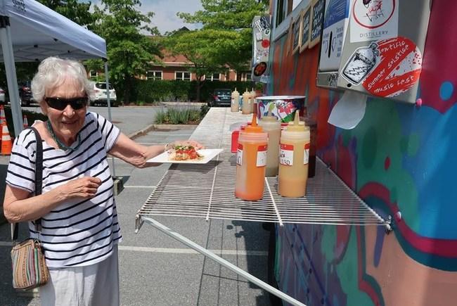 Wake Robin resident enjoying the food trucks