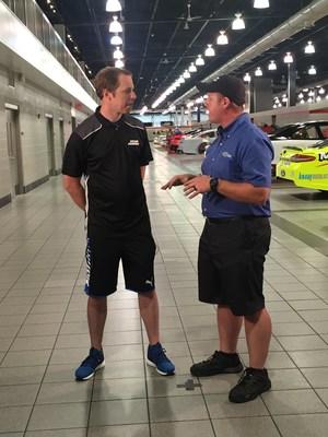 Team Penske Driver Brad Keselowski talks with IndyCar Mechanic Blaine Hardy, a graduate of NASCAR Technical Institute