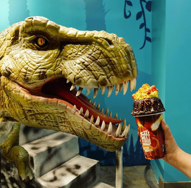 A Robotic T-Rex eating a Meteor Madness milkshake