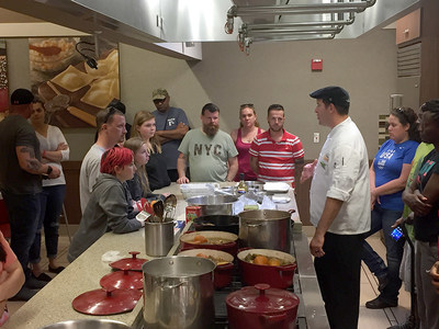 Warriors work together during a healthy cooking class.