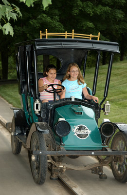 With the Antique Autos ride, families enjoy a scenic journey in replica Model T automobiles.