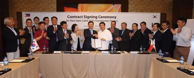 Yun Kyoung-Lim, ninth from left, head of KT's future convergence and global businesses, and Dennis Anthony H. Uy, 10th from left, CEO of Converge ICT Solutions Inc., and other representatives from the two companies are photographed during a signing ceremony for the construction of an optical fiber network in Luzon, held at EDSA Shangri-La in Manila on August 8. (PRNewsfoto/KT Corp.)