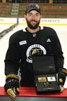 Deryk Engelland holding a set of Vegas Golden Knight credit cards from Credit One Bank