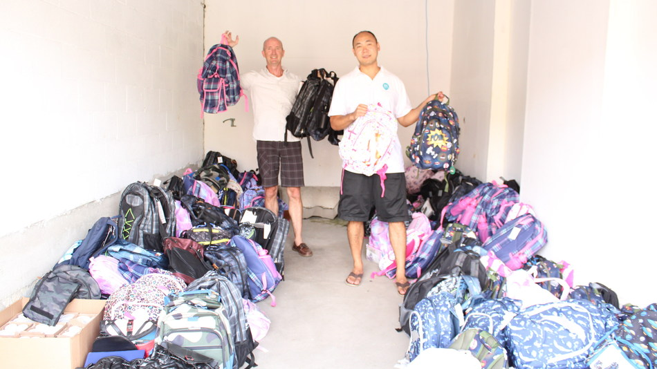Roger Murphy (left) and John Vuong of Local SEO Search with 200 backpacks stuffed with hygiene and school supplies for children in need. (CNW Group/Local SEO Search)