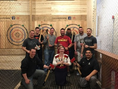 Warriors at axe throwing event with Wounded Warrior Project