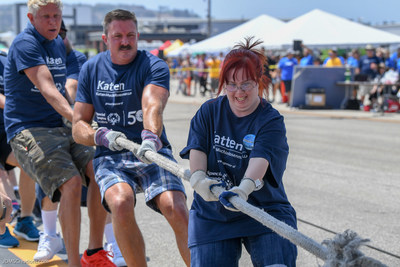 Rachel Osterbach (right), a Special Olympics athlete and honorary copilot, and Katten partner Peter D. Ballance pull a FedEx plane in the 13th annual Special Olympics Southern California Plane Pull. Credit: John Shaffer/Special Olympics Southern California