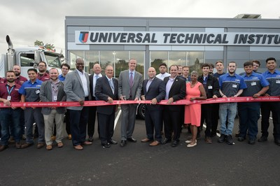 L to R: UTI instructors (maroon shirts), UTI-Bloomfield Education Dir. Peter Fallone, Penske Area HR Mgr. Terrell McCray, UTI-Exton Campus President Bob Kessler, Assemblyman Ralph Caputo, UTI-Bloomfield Campus President Steve McElfresh, Bloomfield Mayor Mike Venezia, Essex Freeholder Carlos Pomares, Assemblywoman Cleopatra Tucker, UTI inaugural students (blue and white shirts)