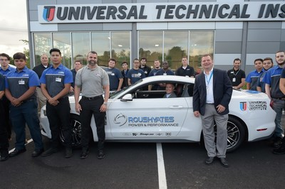 The inaugural class at UTI-Bloomfield with campus president Steve McElfresh (in vehicle)