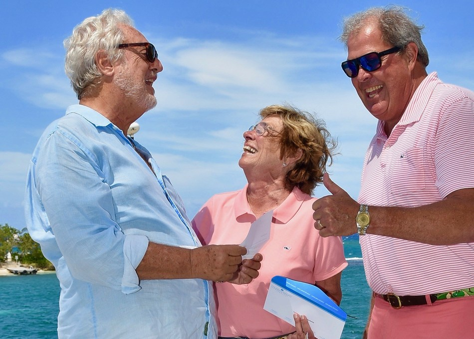 Lee Issa, Chairman and Owner, Couples Resorts, Jamaica share some quiet words and catch-up with Fred and Cynthia Pennekamp who celebrated more than 1000 nights a Couples Resorts during a recent stay.