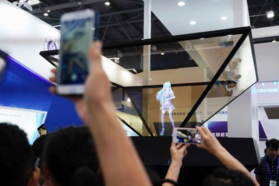 Holographic Imagining Technology Draws Eager Attention at Smart China Expo Exhibition Hall.
