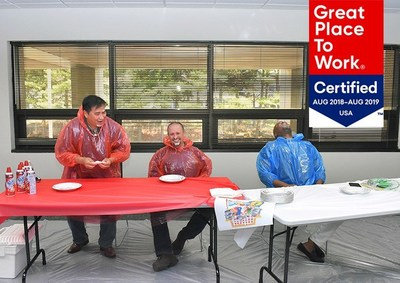 Andrews FCU team members enjoy a good laugh after participating in a pie eating contest during Employee Appreciation Week.