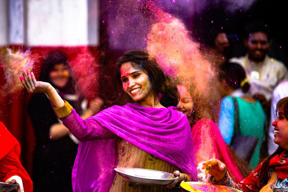 Woman throwing rainbow-dyed powder in celebration of Holi, the annual colourful festival of love. Travellers can witness this magical event by booking with WOW air -- flights starting at $299 from January to March. (CNW Group/WOW air)