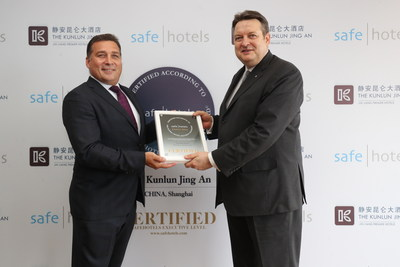 Mr. Gerd Knaust, general manager of The Kunlun Jing An receives the Executive Level Certificate from Mr. Andy Williams VP Business Development and Quality Assurance at the Safehotels Alliance