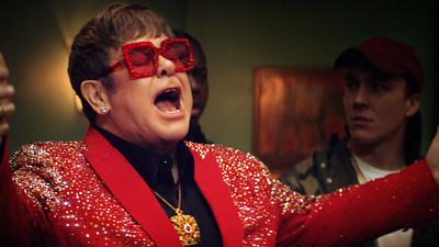 ELTON JOHN BELTS 'DON'T GO BREAKING MY HEART' AMIDST RAP BATTLE IN NEW SNICKERS AD