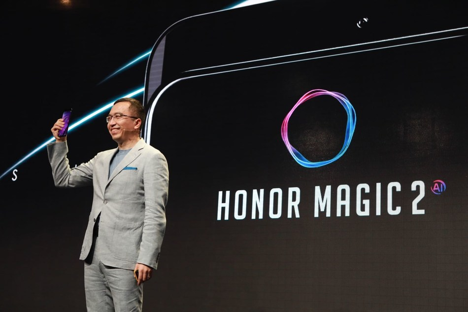 Mr. George Zhao, President of Honor, holding Honor Magic 2 at Honor Play event in Berlin