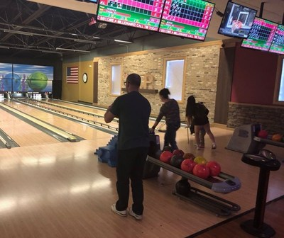 Warriors and family enjoy an evening of bowling with Wounded Warrior Project