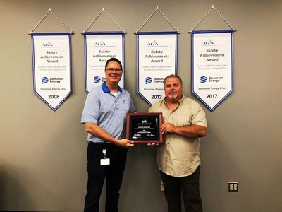Jim Eck, Vice President and General Manager, left, and Eddie Hall, president, Gas Workers Union Local G-555, display Dominion Energy Ohio's American Gas Association Safety Achievement Award. The company has won the award four times in the past 10 years.