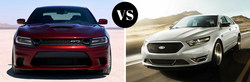 The Dodge Charger is compared to the Ford Taurus.