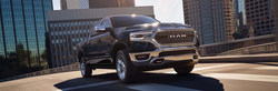 Front passenger side exterior view of a black 2019 Ram 1500