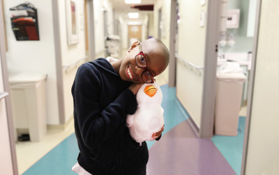 11 year old Teryn Buster, a patient at the Aflac Cancer and Blood Disorders Center in Atlanta cuddles with the My Special Aflac Duck, a comforting robot designed to help children cope with cancer. Aflac will be giving the My Special Aflac Duck to newly diagnosed children across the country, free of charge.