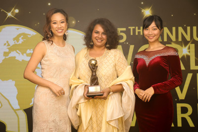 Nidhi Gopal, senior general manager, Deccan Odyssey (centre), is all smiles as she collects the winner's trophy for the luxury train. Deccan Odyssey has been voted as Asia's Leading Luxury Train at the World Travel Awards held in Hong Kong recently.