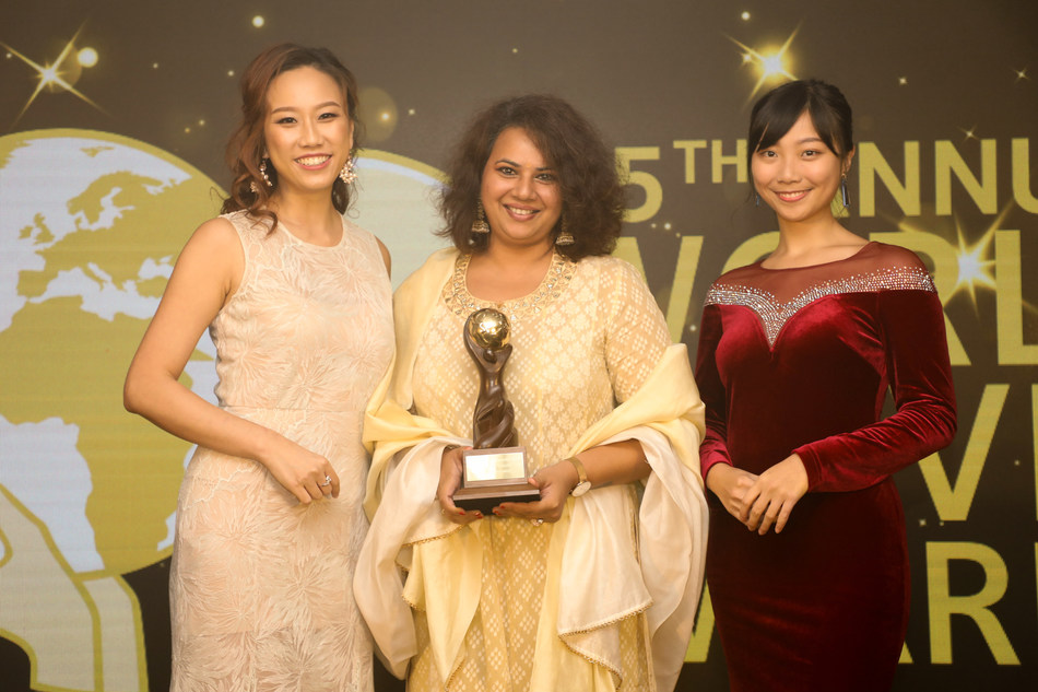 Nidhi Gopal, senior general manager, Deccan Odyssey (centre), is all smiles as she collects the winner's trophy for the luxury train. Deccan Odyssey has been voted as Asia's Leading Luxury Train at the World Travel Awards held in Hong Kong recently (PRNewsfoto/Deccan Odyssey)