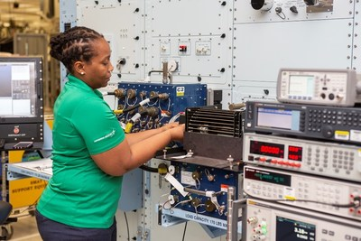 Lockheed Martin technicians build and test eCASS stations, which troubleshoot and repair avionics for Navy aircraft, at a facility in Orlando, Florida. (Photo credit: Michelle Jeffries, Lockheed Martin)