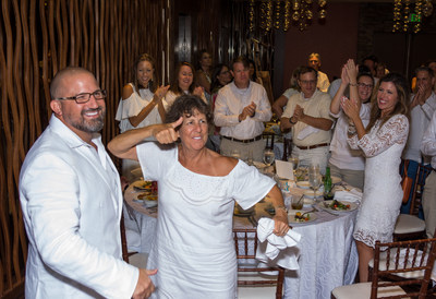 Watercrest team members and guests celebrate the kickoff of the inaugural 2018 Watercrest White Party with principals Marc Vorkapich, CEO and Joan Williams, CFO (foreground) at Costa d'Este resort in Vero Beach.