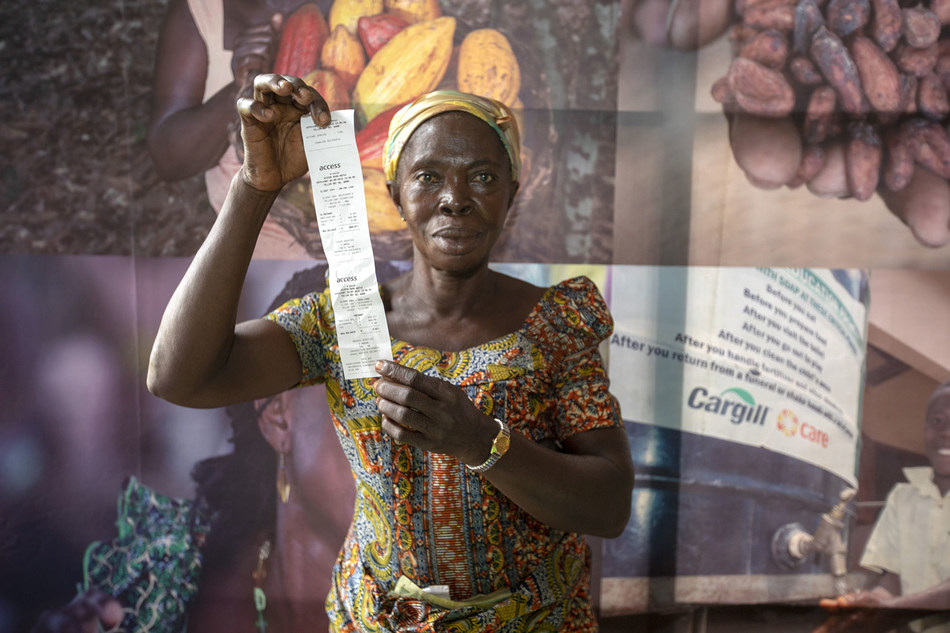 Farmers with receipts for payments. (PRNewsfoto/Cargill)